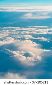 Above The Clouds. This picture was taken out of an airplane and shows the beautiful cloudscape in the evening light.
