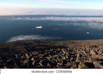 Above the clouds view on endless Arctic Ocean with floating icebergs, Chukotka, Far East Russia