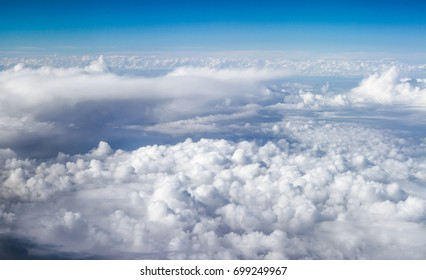 Above the clouds. White clouds. Sea of clouds.