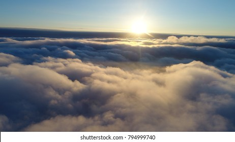 Above the clouds. Yellow clouds. Twilling.