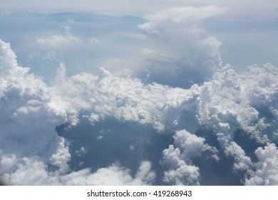 Above the clouds.Aerial cloudscape sky in stratosphere shot from airplane window