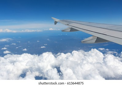 Above the clouds.Wing aircraft on the sky