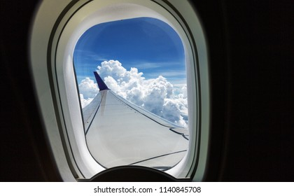Above the clouds.Wing aircraft on the sky,inside view to outside from illuminator window