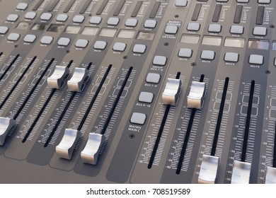 From above different sliders and buttons on professional audio mixing board.