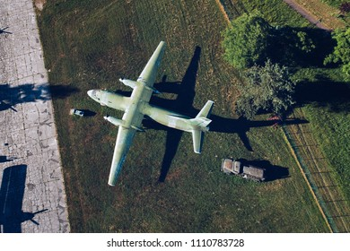 Above drone view onmilitary propeller transport aircraft. Military airfield