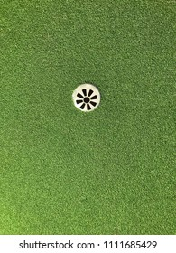 Above of golf hole. Flat image of hole in golf. Empty space for text.