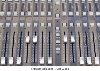 From above gray colored professional audio mixing board.