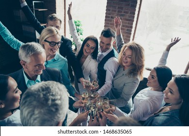 Above high angle view of beautiful attractive cheerful positive elegant classy chic stylish professional business people sharks celebrating company great progress at space workplace workstation