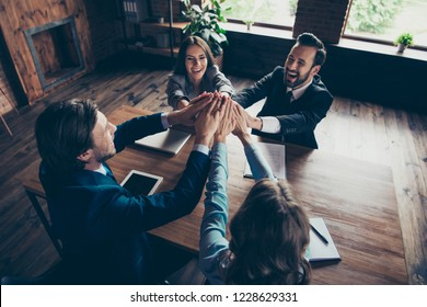 Above high angle view of four adorable stylish elegant classy cheerful businesspeople investors congrats celebrating accomplishment clapping palms great news deal gathering work station place
