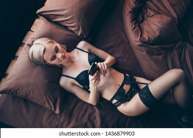 Above high angle view of her she nice-looking sweet gorgeous attractive lovely lovable perfect shape figure lady lying on bed waiting husband boyfriend in hotel house indoors