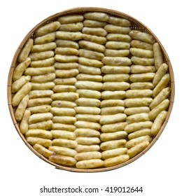Above isolates ripe banana, which lay in a row on a bamboo basket to dry food.
