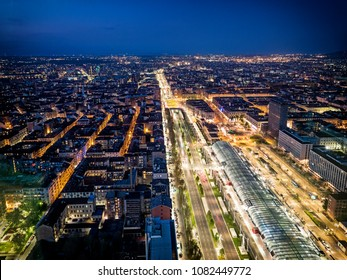 From above panoramic view of Turin city burning with lights in night time, Italy.