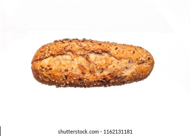 From above of  rustic bread topped with seeds and isolated on white background