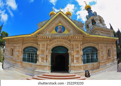 Above the triangular portico golden domes topped with golden crosses. Orthodox Church of Mary Magdalene in Jerusalem