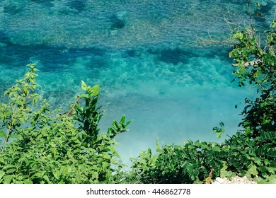 Above tropical sea nature. Bali island view from above. Natural sea reef in Bali, Indonesia. Aerial tropical sea nature. Bali sea views. Tropical island nature paradise. Outdoor exotic nature view