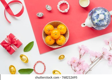 Above view of accessories Lunar New Year & Chinese New Year vacation concept background.Free space for mock up & template.Difference objects on red wooden.Other language mean rich or wealthy and happy