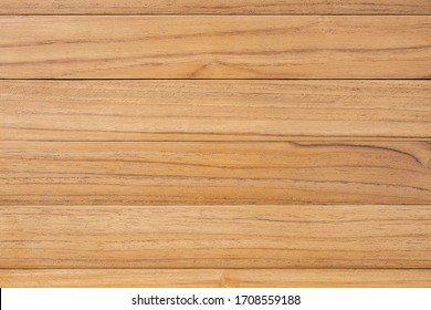 Above view of brown panel wooden texture background. Old striped wood lumber wall. Vintage board floor natural pattern. The surface of the table plank teak. Top view