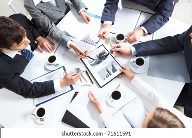 Above view of business team discussing papers
