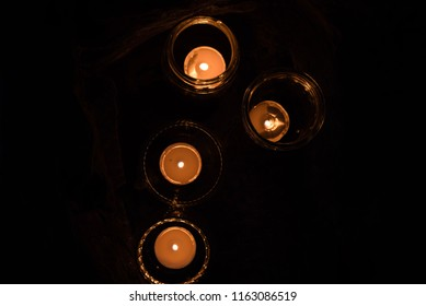 above view of candles on stone steps night