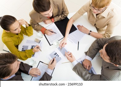 Above view of communicating business partners during meeting