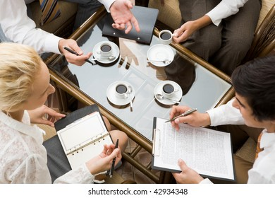 Above view of confident businesspeople planning work in the room