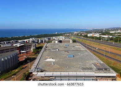 Above view of construction development and commercial and residential buildings urban coastal landscape against blue Durban city skyline in South Africa