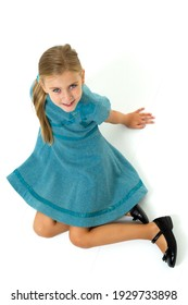 Above view of girl sitting on floor