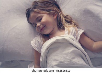 Above view of little girl in bed.