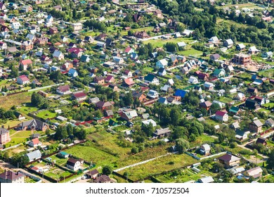 above view of many cottages in suburb village in Moscow Region near Ivanovskoye settlement in Istrinsky district in summer day