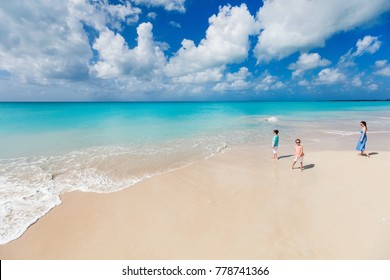 Above view of mother and kids enjoying tropical beach vacation