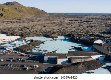 Above view of natural outdoor spa - The Blue Lagoon crowded with people