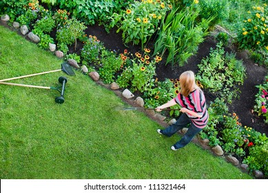 From above view on woman working in garden.