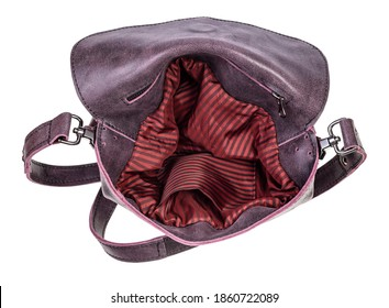 above view of open empty handcrafted crossbody bag with red lining handmade from soft genuine leather isolated on white background
