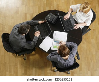Above view of people working at desk