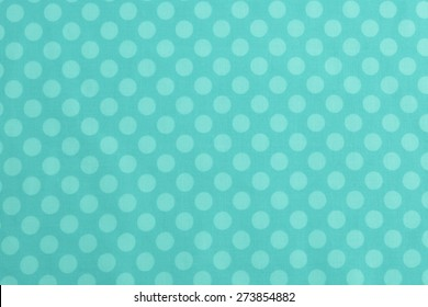 Above View of Polka Dot Woven, Cotton Fabric for a Colorful, Monochromatic Cyan, Teal or Turquoise Background Template, use horizontal or vertical with room or space for text, copy, words.  Photo