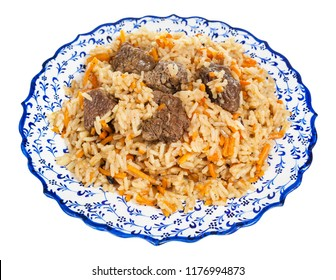 above view of prepared pilau (central asian dish from rice with meat and vegetable) on local ceramic plate isolated on white background