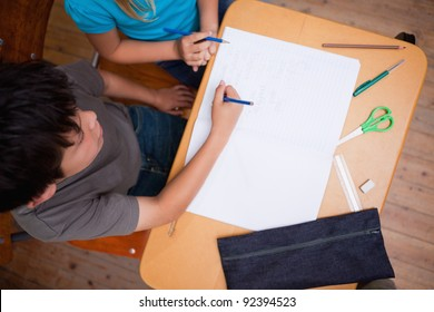 Above view of pupils working together in a classroom
