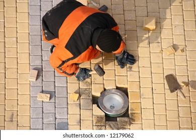 Above view of road worker making pavement