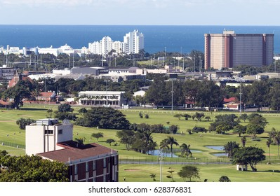 Above view of Royal Durban Golf course and Greyville horse racing track against city and coastal skyline in South Africa