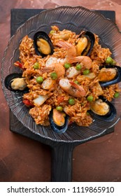 Above view of spanish paella with seafood, vertical shot, closeup