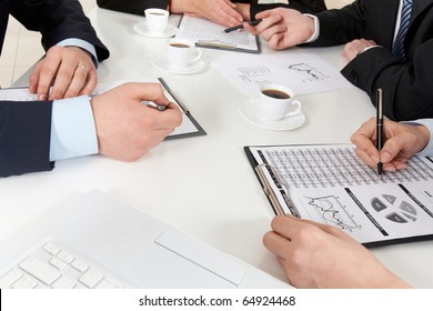 Above view of successful business team working with documents