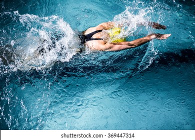 Above view of swimmer woman swimming in the swimming pool