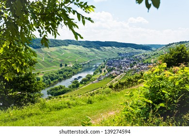 above view of town Zell in Moselle valley and Mosel river in summer day, Germany