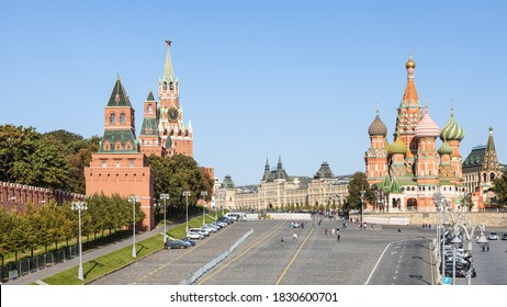 above view of Vasilevsky Descent of Red Square and Kremlin Tower and Vasily the Blessed Cathedral in Moscow city from Bolshoy Moskvoretsky Bridge on sunny autumn day