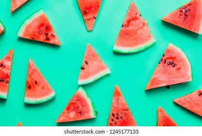 Above view at watermelon parts on green background