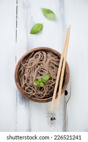 Above view of a wooden bowl with buckwheat soba noodles