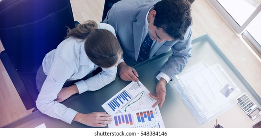 Above view of young consultant analyzing data with her client