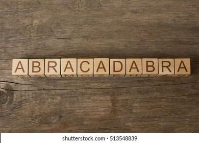 abracadabra word on wooden cubes