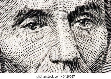 Abraham Lincoln close up from 5 dollar bill