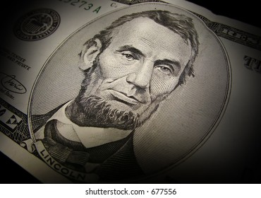 Abraham Lincoln from the front of a $5 bill.